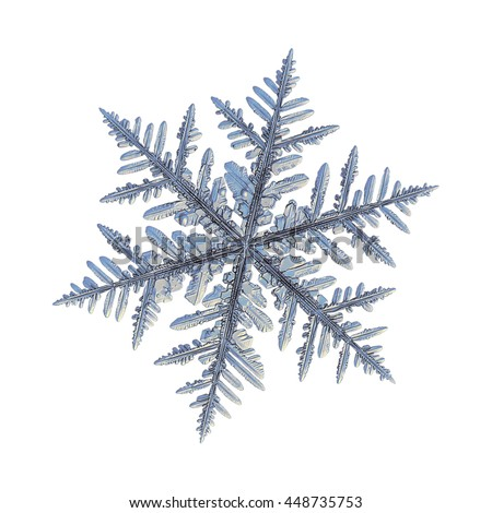 Snowflake isolated on white background: macro photo of real snow crystal, captured on glass. This is fernlike dendrite crystal: very common type of big and complex snowflakes with traditional look.
