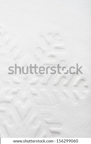 Snowflake shape on the snow. White xmas holiday background. - stock photo