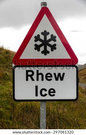 Snowflake triangular warning sign, Wales, warning of Ice, Welsh bilingual Rhew, United Kingdom - stock photo