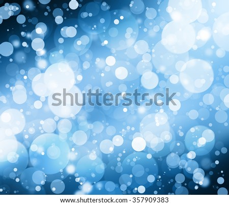snowflakes and stars descending on  bokeh background