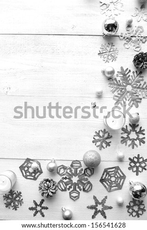 Snowflakes,candle and Christmas ornaments.Paper cutout of snowflakes.