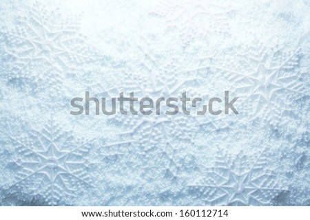 Snowflakes on snow - stock photo