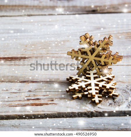 Snowflakes on wooden background. Winter holidays concept.