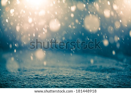 Snowing at Night and Back light for a Magical Effect - stock photo