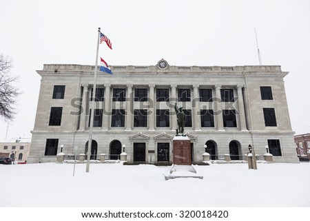 Snowing by Pettis County Courthouse in Sedalia - stock photo