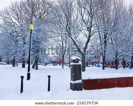 Snowing in the park in Leeds, UK. - stock photo