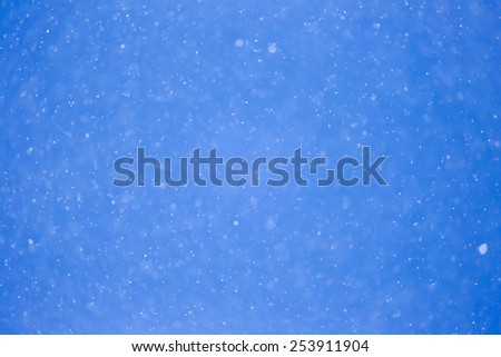 snowing on a blue sky - stock photo