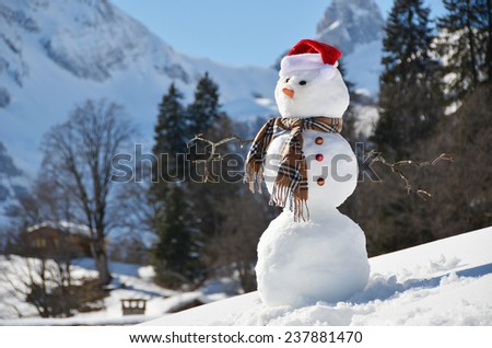 Snowman against Alpine panorama - stock photo