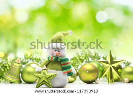 Snowman and christmas decoration on abstract background - stock photo