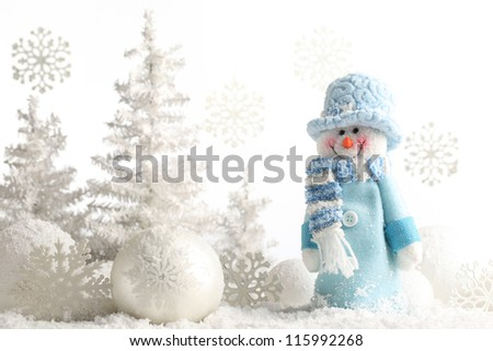 Snowman and Christmas decorations. - stock photo