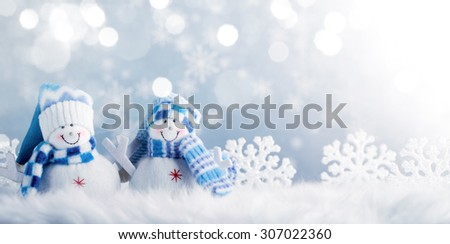 Snowman and Christmas decorations in the snowy day. - stock photo