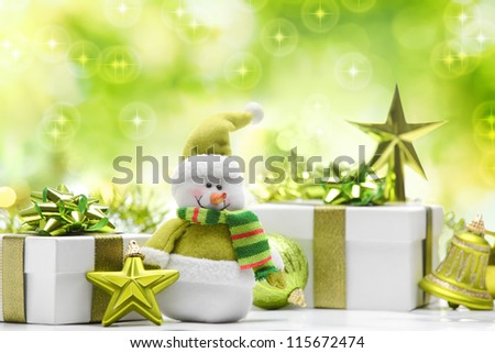 Snowman and gift boxes on abstract background - stock photo