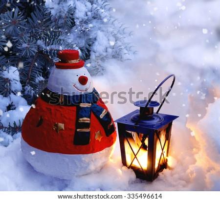Snowman and Lantern - stock photo
