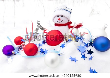 Snowman and multicolored Christmas balls in the snow 2 - stock photo
