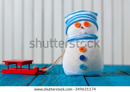 Snowman and  red sled - Christmas, New Year decorations - stock photo