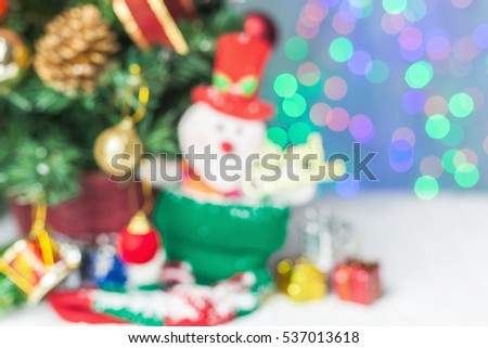 snowman background with christmas tree out of focus