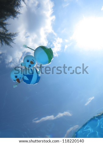snowman beach vacation holidays from cold winter - stock photo