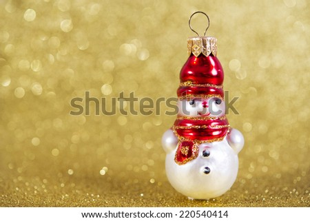 snowman. christmas decoration on yellow bright holiday background - stock photo