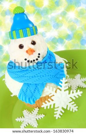 Snowman cupcake. - stock photo