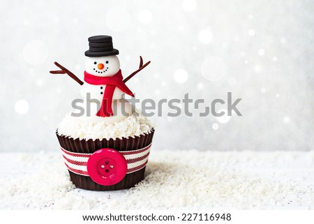 Snowman cupcake with copyspace to side - stock photo