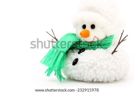 Snowman in green scarf on white background. - stock photo