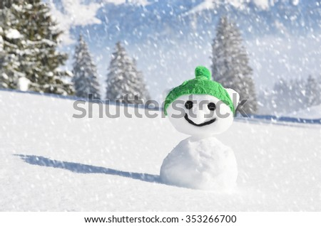 Snowman in the knitted cap - stock photo
