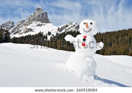 Snowman in the Swiss Alps - stock photo