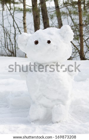 Snowman in the winter forest - stock photo