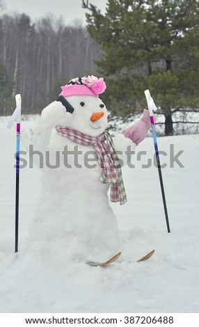Snowman is skiing and talking on the phone. - stock photo
