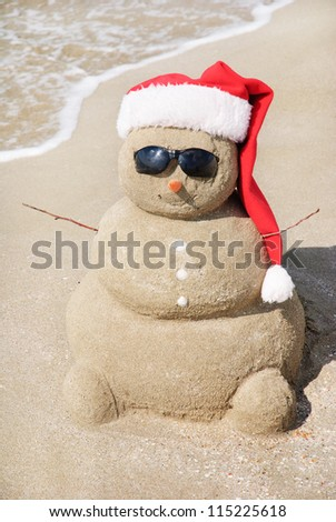 Snowman made out of sand. Holiday concept can be used for New Year and Christmas Cards - stock photo
