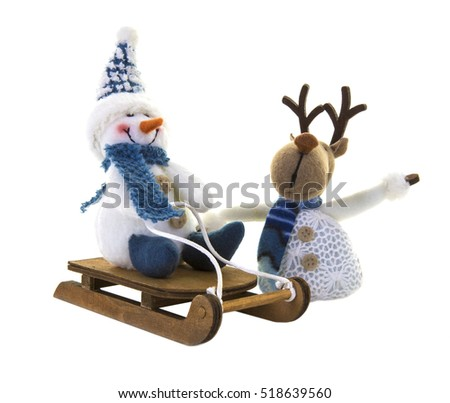 Snowman on a sledge with reindeer on a white background.