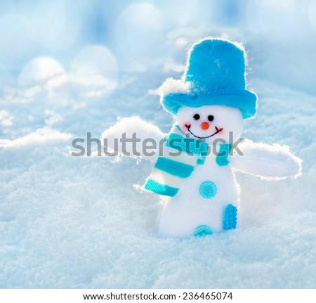Snowman on snow. Christmas decoration. Winter - stock photo