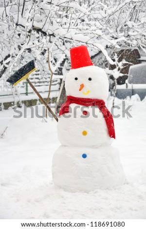 snowman on snowy garden - stock photo