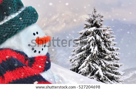 snowman on snowy mountain background with fir