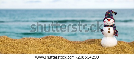 snowman on summer holidays. Travel concept - stock photo