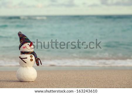 Snowman on the beach,Christmas concept. - stock photo