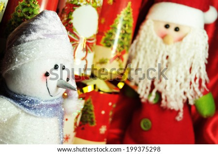 Snowman, presents and Father Christmas decorations (selective focus on snowman)