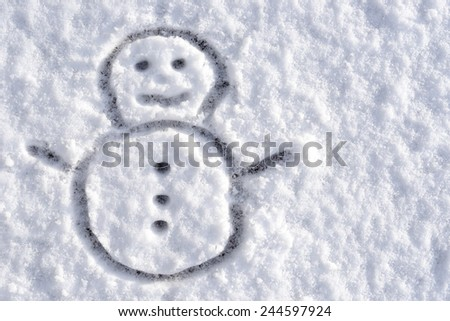 snowman sketch drawn in real snow - stock photo