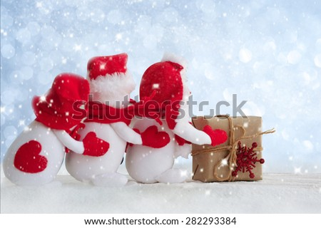 snowman standing in the snow - stock photo