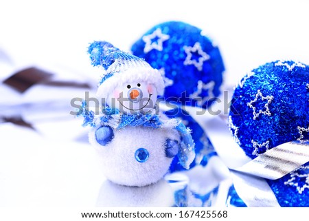 Snowman wearing hat and scarf. Christmas decoration. - stock photo