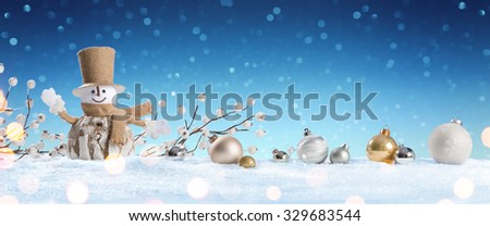 Snowman With Baubles On Snow  - stock photo