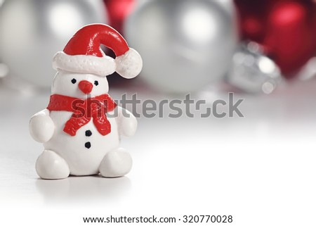 Snowman with Santa hat. Christmas greeting card with copy space - stock photo