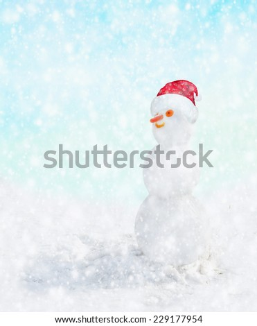 snowman with Santa hat in winter snow fall, Christmas card