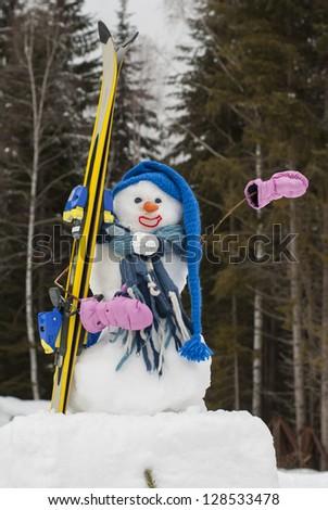 Snowman with ski gear - stock photo