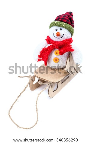 Snowman with sledge and Christmas tree isolated on a white background.
