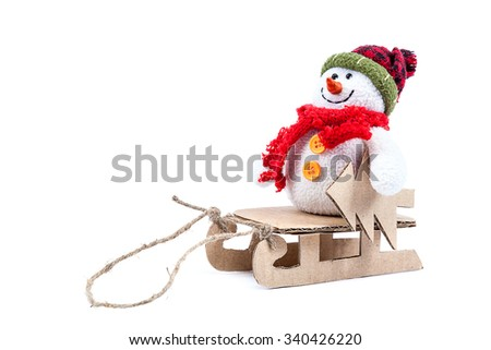 Snowman with sledge and Christmas tree isolated on a white background. - stock photo