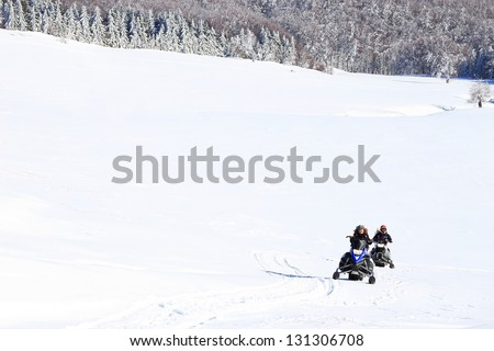 Snowmobile in the outdoors - stock photo