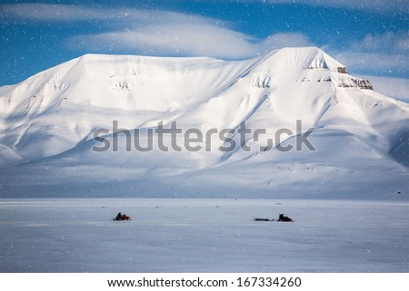 Snowmobiling, Wintry Landscape, Arctic North Pole, Svalbard.  - stock photo