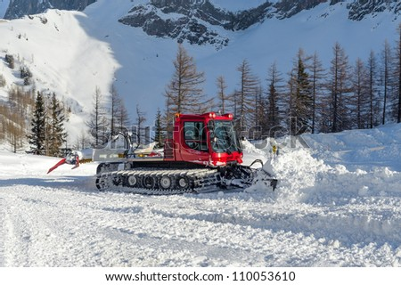 Snowplow make a way in winter