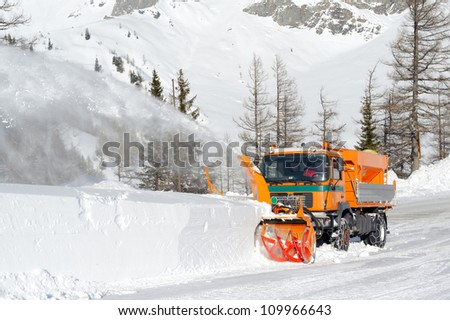 Snowplow removing snow from intercity road from snow blizzard